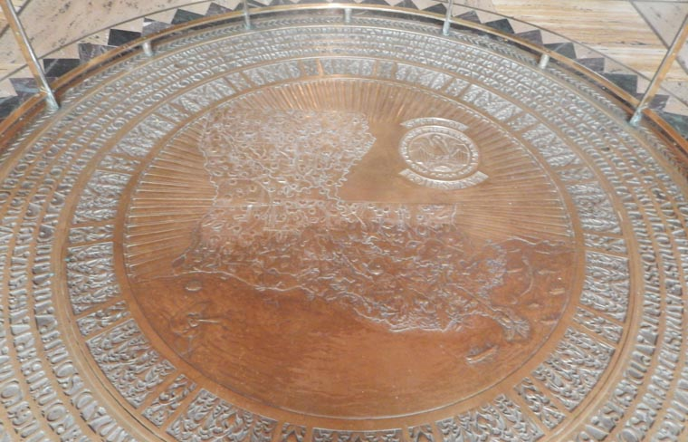 Legends and lore of the state capitol the bronze medallion in memorial hall has a map of the state children try to toss coins onto their hometown photo david kunian freerunsca Choice Image