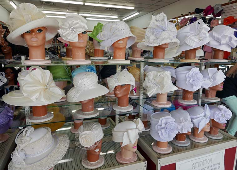bfa58fb69ca3c4 From the simple to the sublime: white hats on display in Four Seasons  boutique. Since they are a neutral color and worn by women with various  church roles, ...