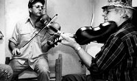 "Larry ""Bubba"" Frey with master fiddler Harry Lafleur."